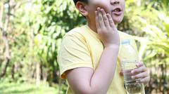 Asian boy with toothache - stock photo
