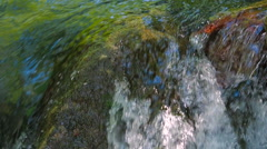 Stream Water Rapidly Falling off Rock. Close-up shot with sound Stock Footage