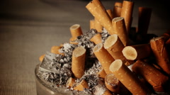 Ashtray with cigarette butts Stock Footage