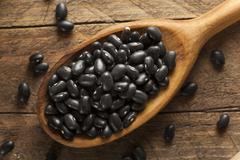 Organic Raw Dry Black Beans Stock Photos