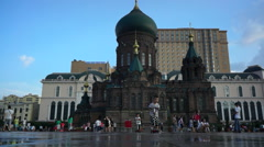 Children playing on the square of St. Sophia Cathedral in Harbin Stock Footage
