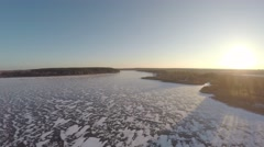 Flight over the frozen reservoir Stock Footage