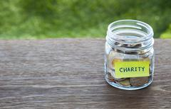Charity donation money glass jar Stock Photos