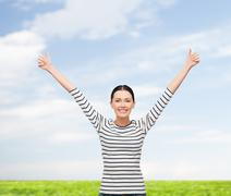 smiling girl in casual clother showing thumbs up - stock photo