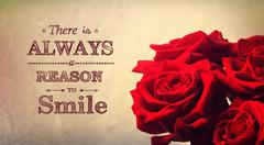 There is always a reason to smile text with red roses - stock photo