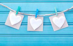 Hanging blank note tags with felt hearts Stock Photos