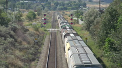 railroad, freight train going away long lens overhead shot - stock footage