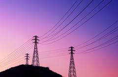 High voltage transmission towers - stock photo