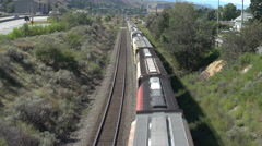 Railroad, freight train going away tail end overhead shot medium shot Stock Footage