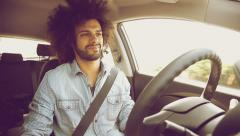 Handsome cool man starting to smile driving car - stock footage