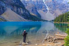 Photographer at Moraine Lake in Banff National Park, Alberta, Canada - stock photo
