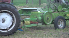 Agriculture, tractor baling follow shot Stock Footage