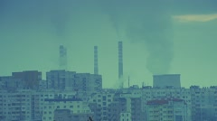 Power plant with working chimneys and old blocks of communism - stock footage