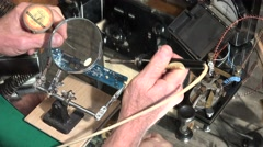 Soldering , magnifying glass Stock Footage