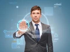 Attractive buisnessman wotking with virtual screen Stock Photos