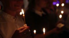 Candles in the hands of the people Stock Footage