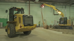Yellow Loader and Excavator working Warehouse Construction Site Stock Footage