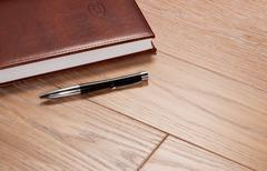 Daily log and the handle on a wooden background Stock Photos