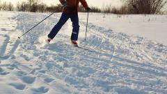 Cross-country skiing in sunny day. Athlete slow motion towards the camera Stock Footage