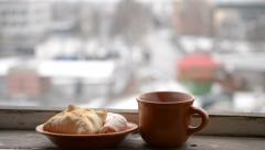 Cup with hot drink steaming and buns on saucer Stock Footage