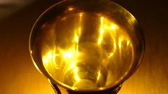 Falling coins (slowly) in a golden cup Stock Footage