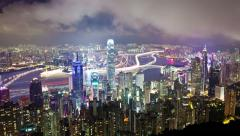 Timelapse video of Hong Kong at night with growing traffic trails, zooming in Stock Footage
