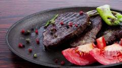 Fresh roast beef fillet mignon on old retro style cast iron Stock Footage