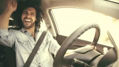 Happy man driving car retro look singing on music Stock Footage
