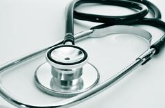 Stethoscope on the desk of a doctor Stock Photos