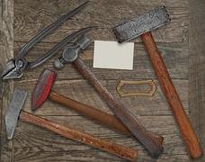 blacksmith tools and business card over bench - stock photo