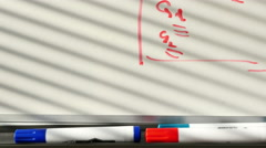 Close up of student white board in a high school, dolly Stock Footage