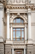 Architectural window with columns and moldings barilefom Stock Photos