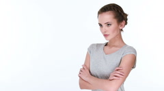 Upset serious woman with crossed arms  posing at camera Stock Footage