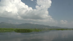 Inle lake, floating on lake and mountains on background Stock Footage
