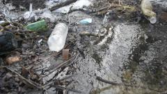 Brook littered with household wastes - stock footage