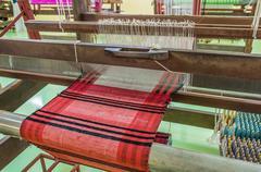 Weaving loom and shuttle on the warp. Kuvituskuvat