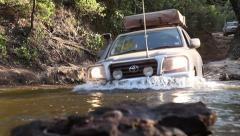 4WD crossing creek - stock footage