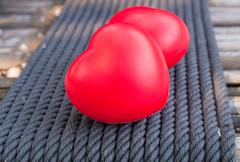 Red heart in love of Valentine's day with wood background. Stock Photos