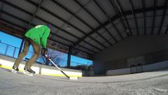 4k hockey player stickhandling around the camera Stock Footage