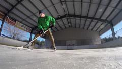 Hockey players uses fancy footwork to deke Stock Footage