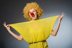 Funny woman in clown dressing Stock Photos
