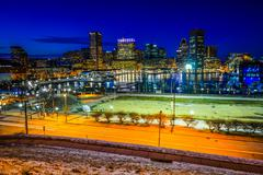 View of the Baltimore skyline and Inner Harbor at night, seen from Federal Hi Stock Photos