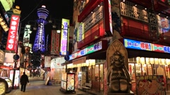 Osaka, JP - January 24, 2015:  Pedestrians walking down Shinsekai shopping Stock Footage
