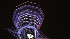 Osaka, JP - January 24, 2015:  The 91-meters-tall Tsutenkaku Tower is Stock Footage