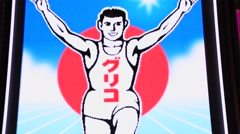 Osaka, JP - January 24, 2015:  The Glico Running Man at Dotonbori shopping Stock Footage