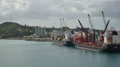New Caledonia Noumea loading ship pan toward shore 4k Stock Footage