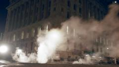 steam smoke over city street. traffic cars lights. night city scenery - stock footage