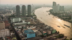 Stock Video Footage of Timelapse hight view of Bangkok city with modern building along Chaopraya riv