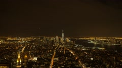 Overlooking city metropolis at night. illuminated urban streets lights. new york Stock Footage