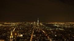 Overlooking city metropolis at night. illuminated urban streets lights. new york Arkistovideo
